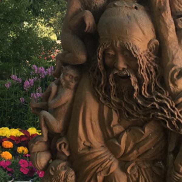 工艺木雕根雕寿山石雕厂家生产各种工艺品摆件老雕件龙眼木东方朔偷桃图片