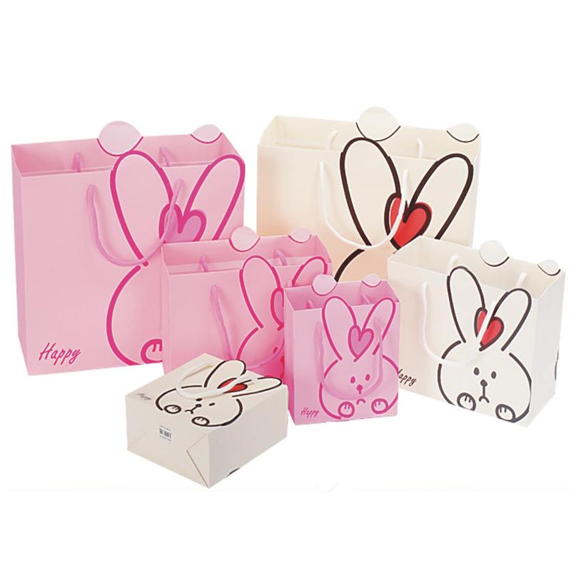 可爱卡通图案礼品袋 儿童生日礼物纸袋 糖果袋回礼袋 创意礼品袋图片
