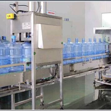 全自动在线刷桶拔盖机_桶装水灌装生产配套设备_四川成都桶瓶装水成套设备厂家